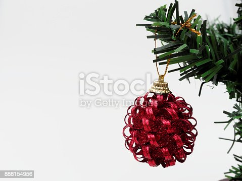 Red Christmas ball hanged on green christmas pine tree branch isolated on white background used for decoration in Christmas and New Year event