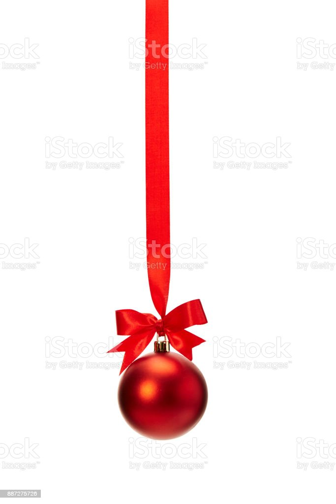 red christmas ball hanging on ribbon with bow stock photo