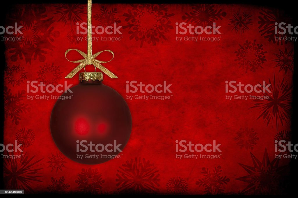 Red Christmas Ball Infront Of Snowflake Background royalty-free stock photo