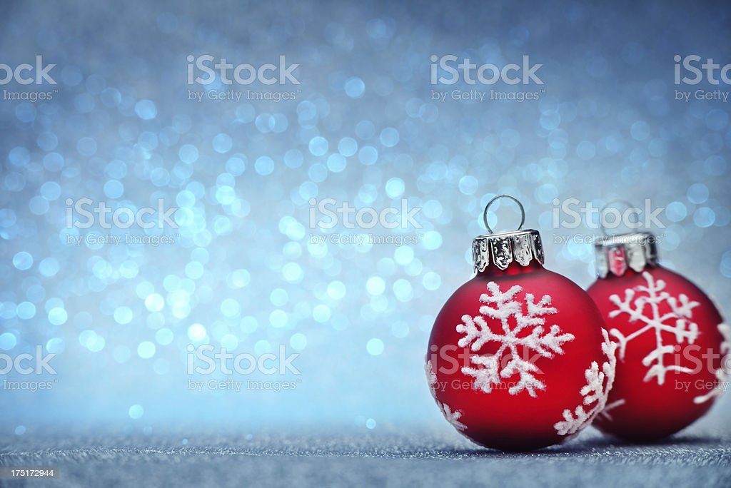 Red christmas ball on blue glitter background royalty-free stock photo