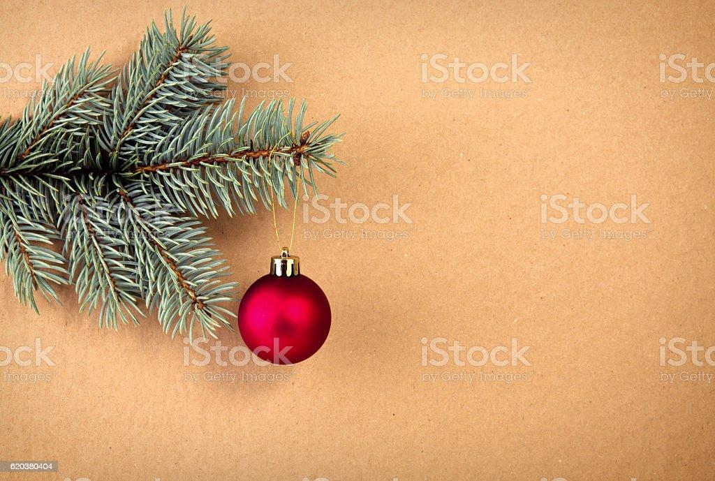 Red Christmas ball on green spruce branch isolated . zbiór zdjęć royalty-free