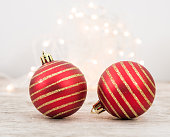 istock Red Christmas Ball On Wood Background 1072008964
