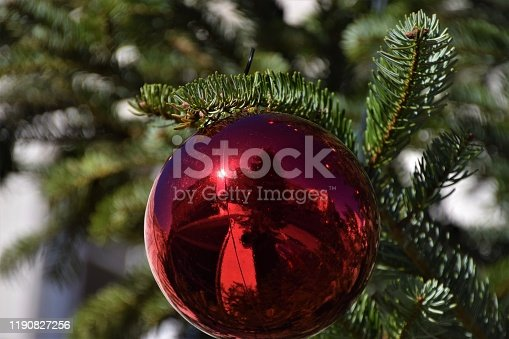 858960516 istock photo Red Christmas ball ornament on tree detail 1190827256