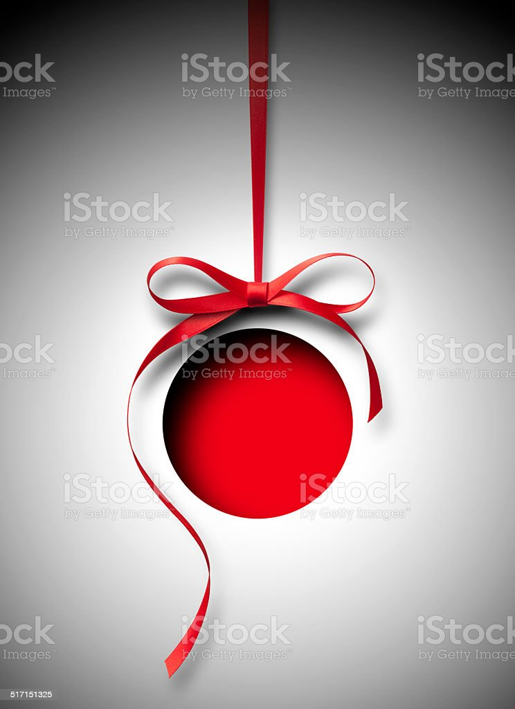 Red Christmas ball. Paper cut on a red background. stock photo