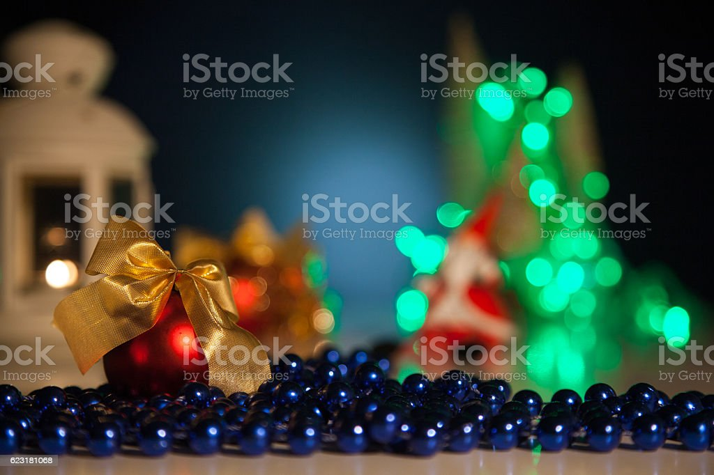 Red Christmas Ball With Beads On A Background Of Lights