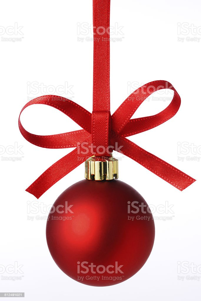 Red Christmas ball with red ribbon against white background stock photo