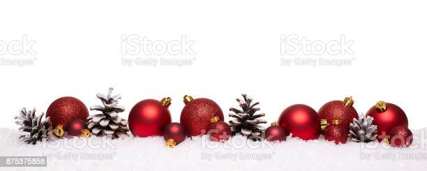 Red christmas balls and pine cones isolated on snow picture id875375858?b=1&k=6&m=875375858&s=612x612&h=xjg04ogwg4m9vijpaz1naaqoq7tajbykepeby6p c e=