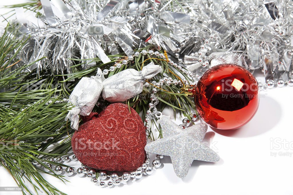 Red Christmas balls and silver star on pine branch royalty-free stock photo