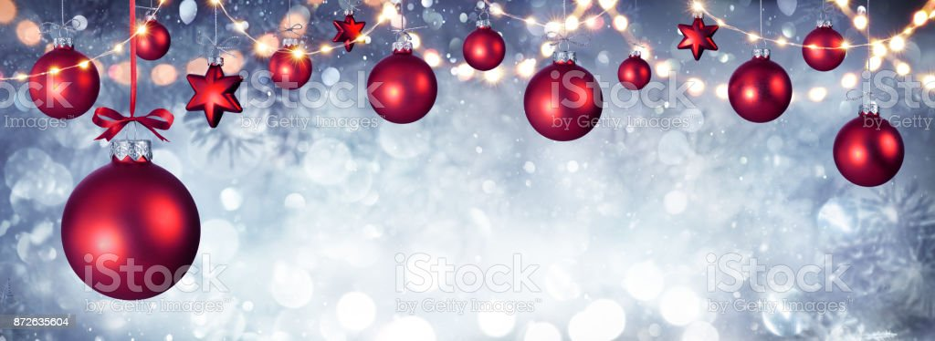 red christmas balls hanging with string lights royalty free stock photo - Red Christmas Balls