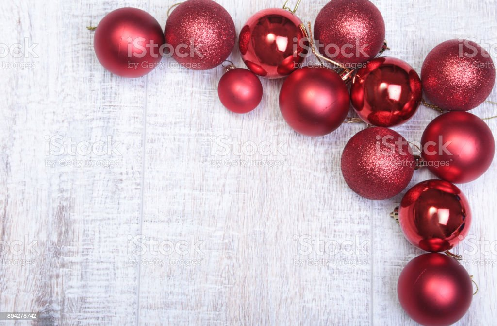 Red christmas balls on a wooden background royalty-free stock photo