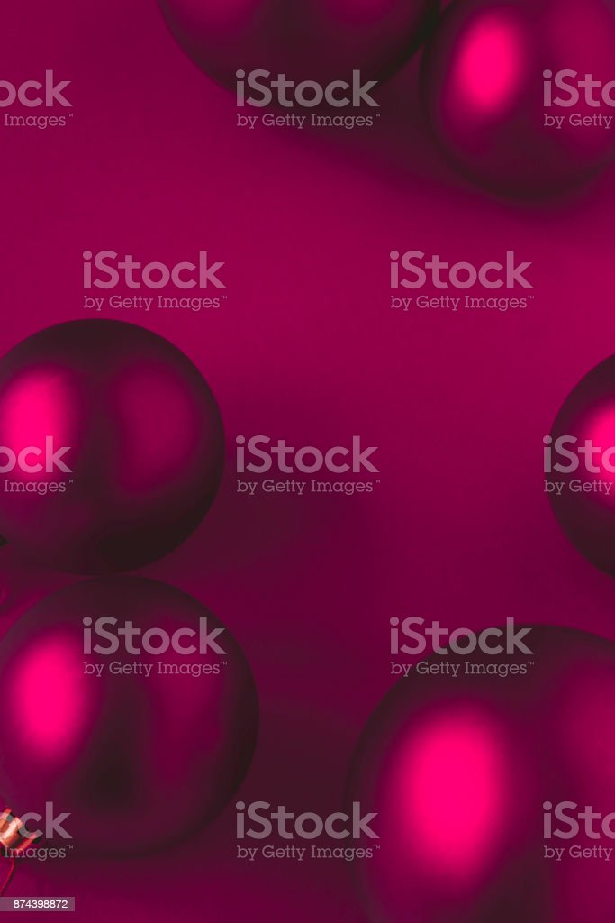Red Christmas balls on red background stock photo