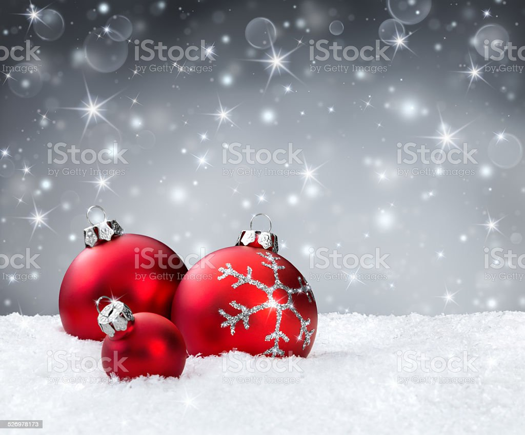 red christmas balls on snowflakes stock photo