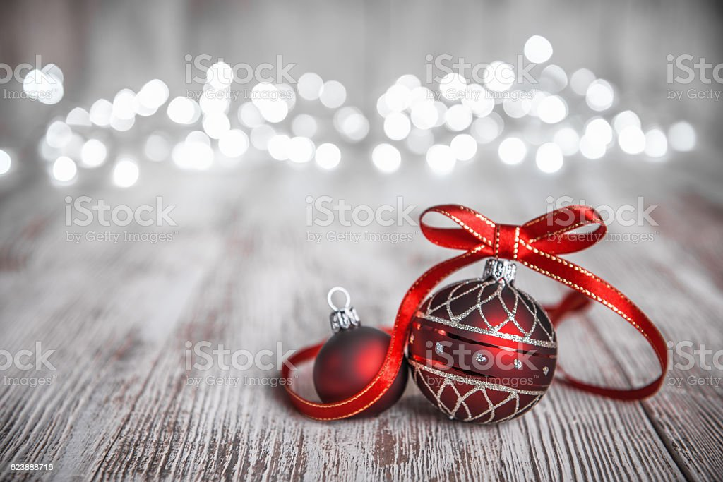 Red christmas balls ribbon bow decorated on rustic board stock