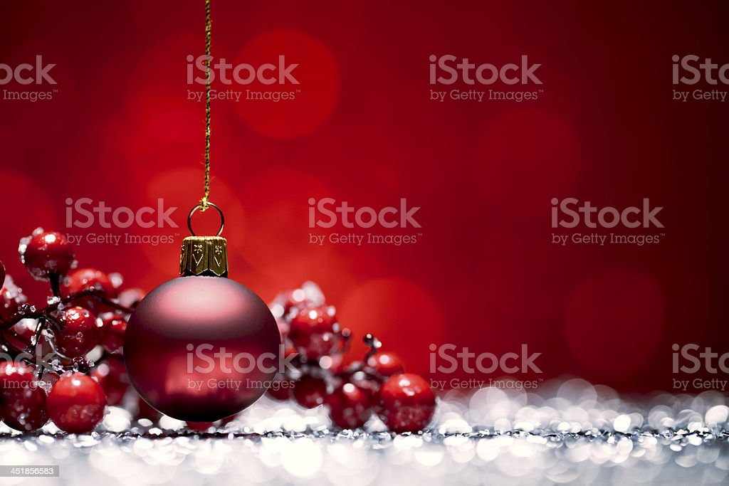Red Christmas Bauble - Glitter Bokeh Hanging stock photo