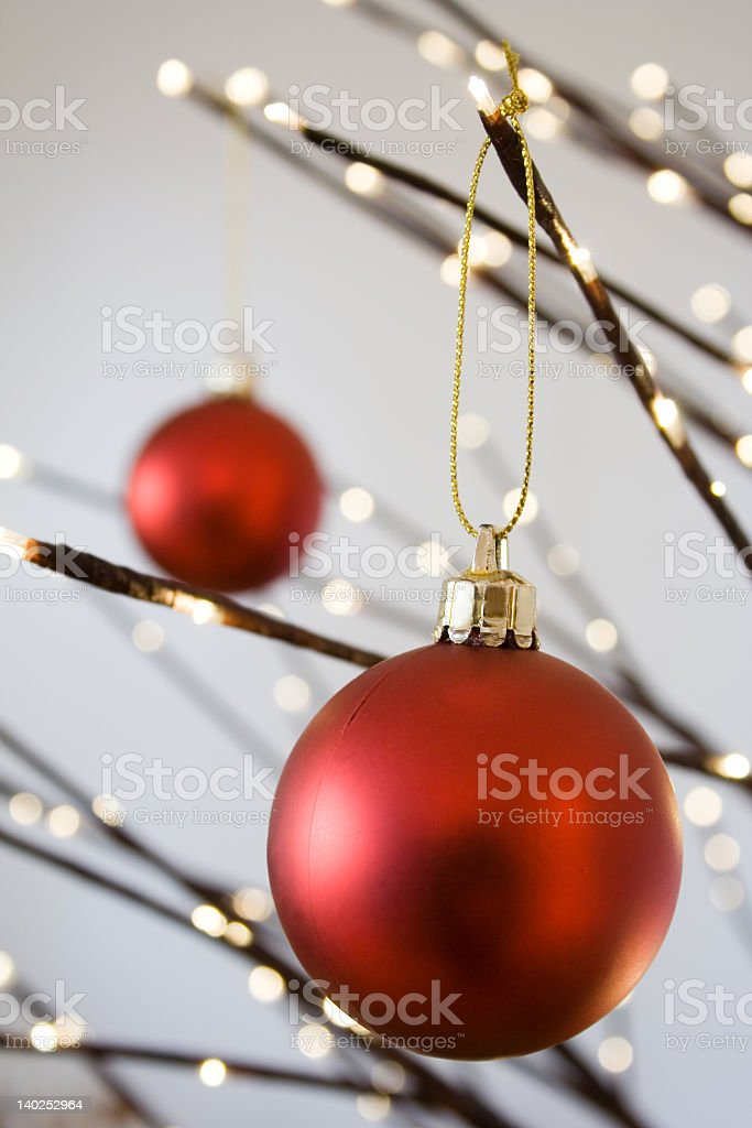 Red Christmas bauble in close-up against blurred background royalty-free stock photo