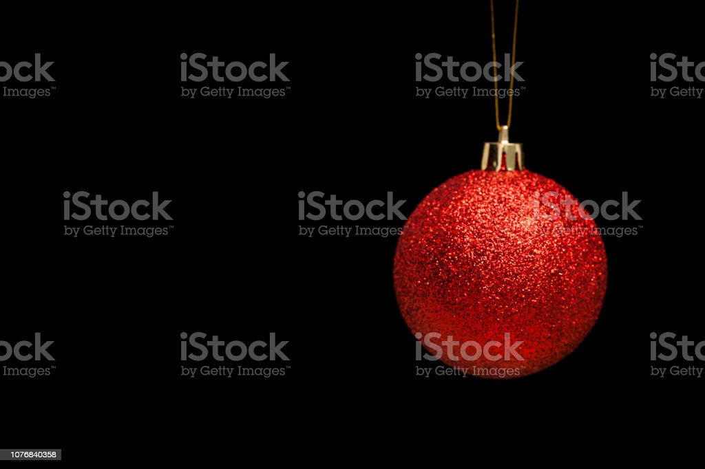 Red Christmas Bauble on Black Background stock photo