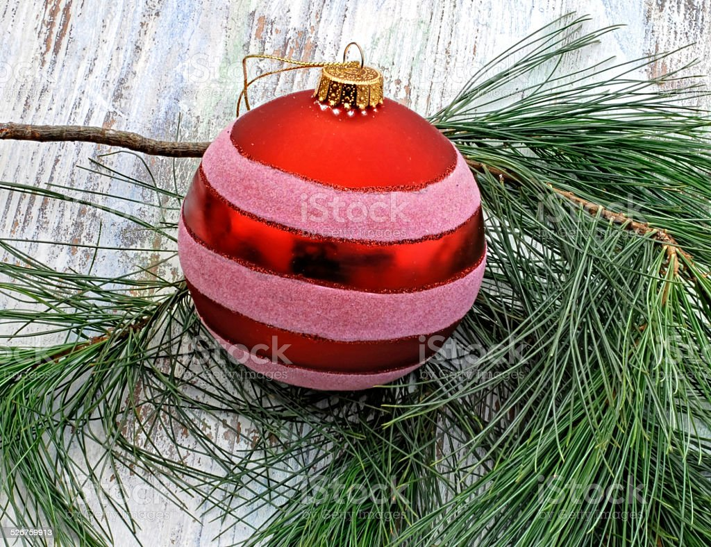 red Christmas bauble with fir branch stock photo