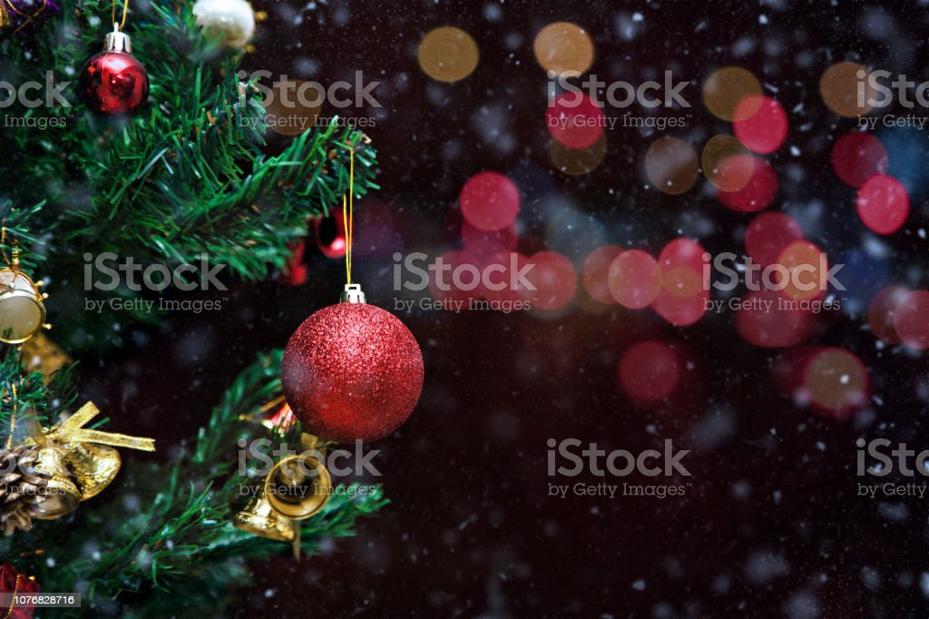 Red Christmas Bauble with snow on Black Background stock photo