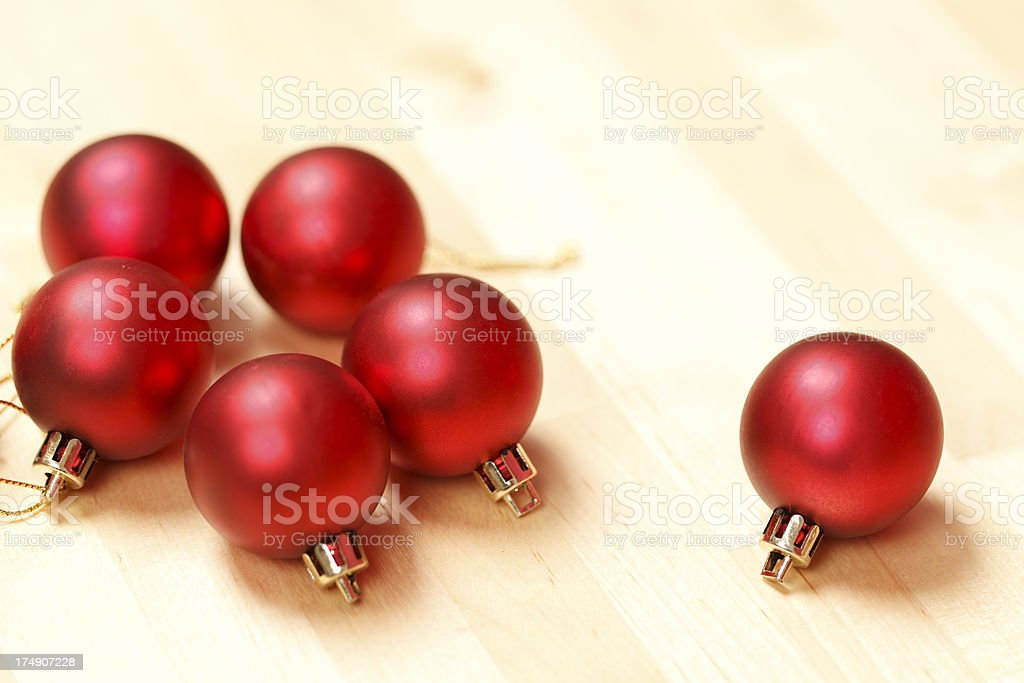 Red Christmas baubles on a wooden surface royalty-free stock photo