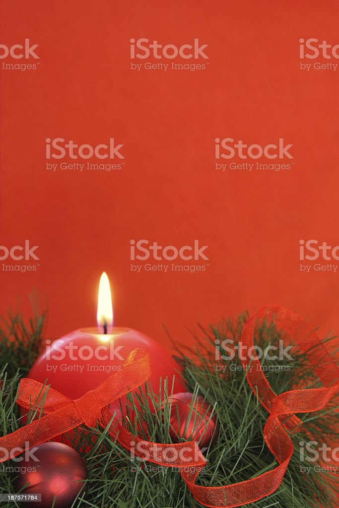 Red christmas candle and baubles with fir royalty-free stock photo