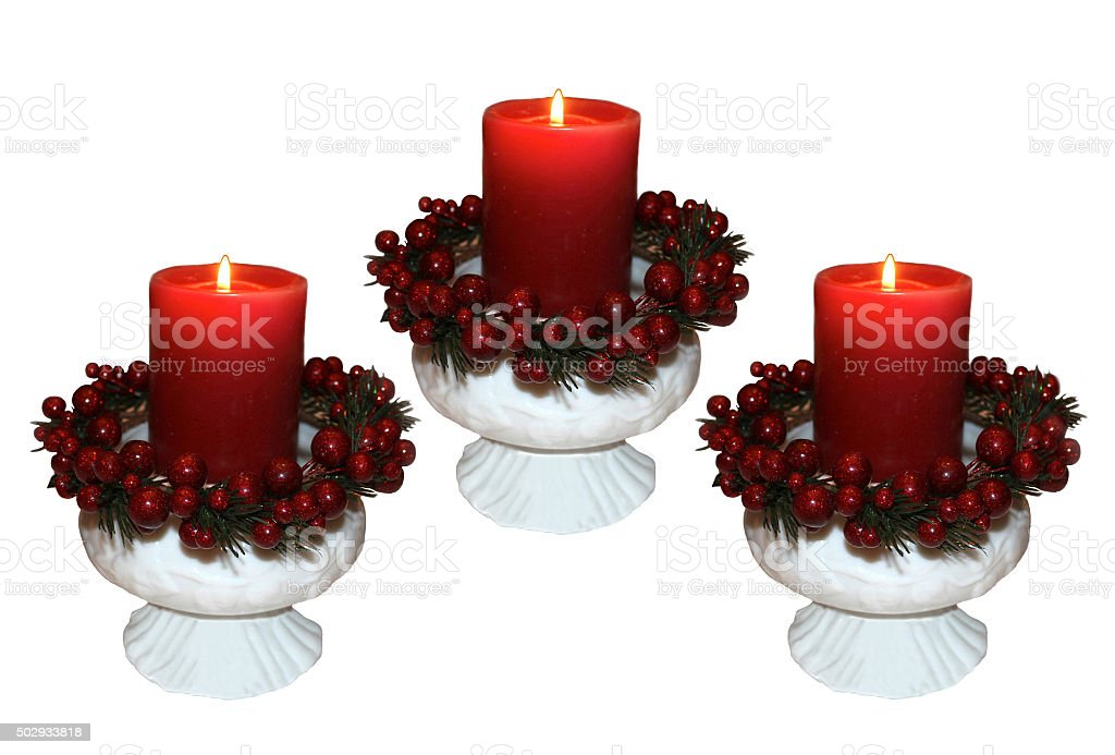Red Christmas Candles in Fenton Milk Glass with Cranberry Wreath stock photo