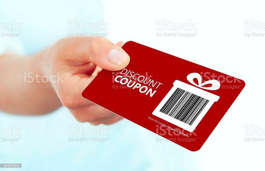 red christmas coupon holded by hand over white stock photo