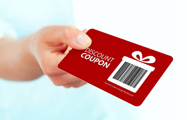 red christmas coupon holded by hand over white red christmas coupon holded by hand over white background. focus on coupon. Bar code is designed and generated by author salé morocco stock pictures, royalty-free photos & images