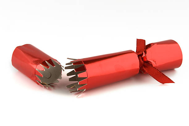 Red Christmas Cracker isolated on a white background stock photo