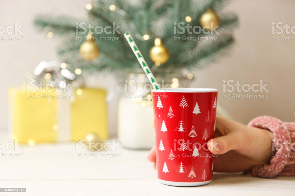 Red Christmas cup in hand. stock photo