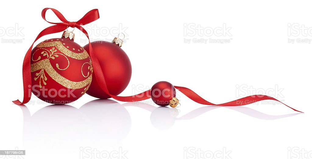 Red christmas decoration balls with ribbon bow isolated on white stock photo