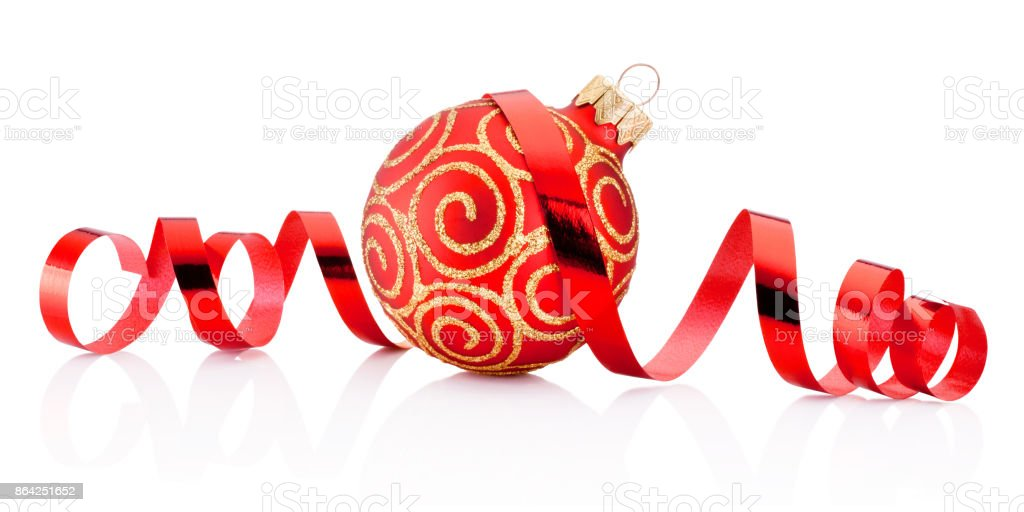 Red Christmas decoration bauble and curling paper isolated on white background royalty-free stock photo