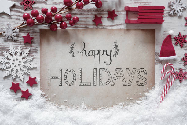 red christmas decoration, snow, calligraphy happy holidays - happy holidays stock pictures, royalty-free photos & images