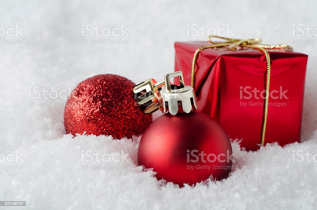 Red Christmas Decorations in Snow stock photo