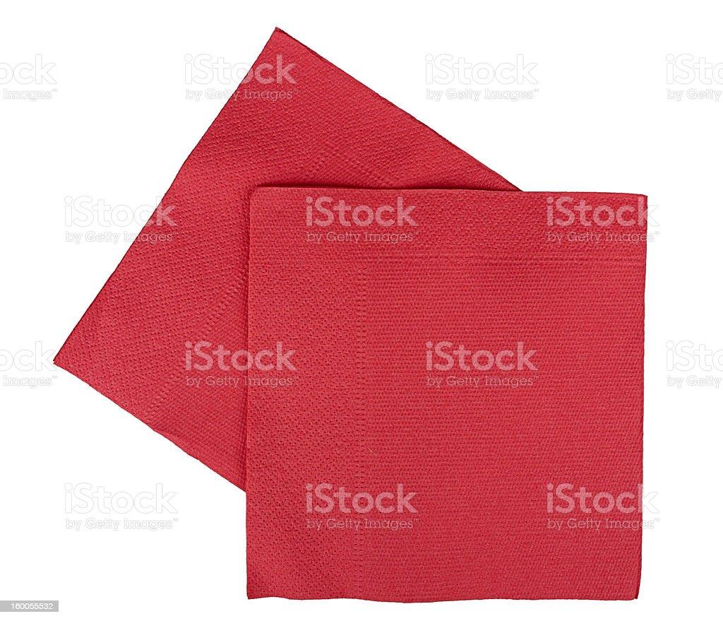 Red Christmas or festive paper napkins aka serviettes, white background stock photo