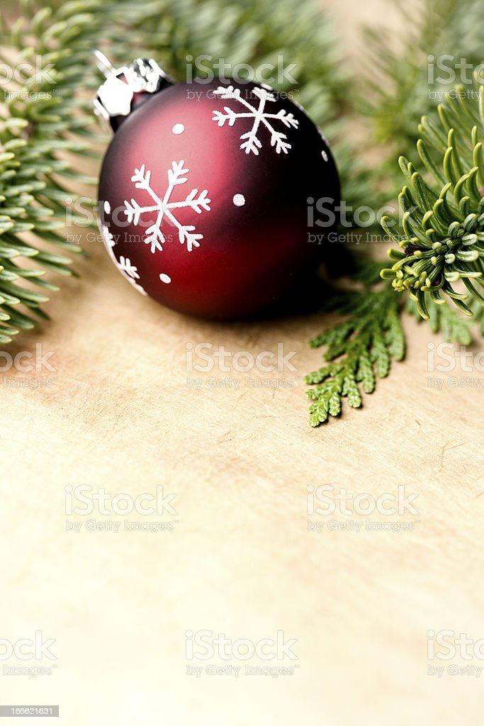 Red Christmas Ornament with Fresh Greenery royalty-free stock photo