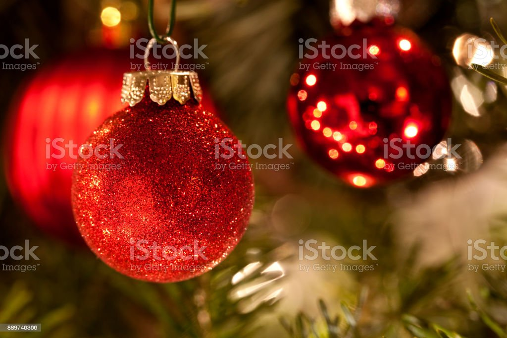 Tungsten light enhances the holiday look of Christmas tree balls on...