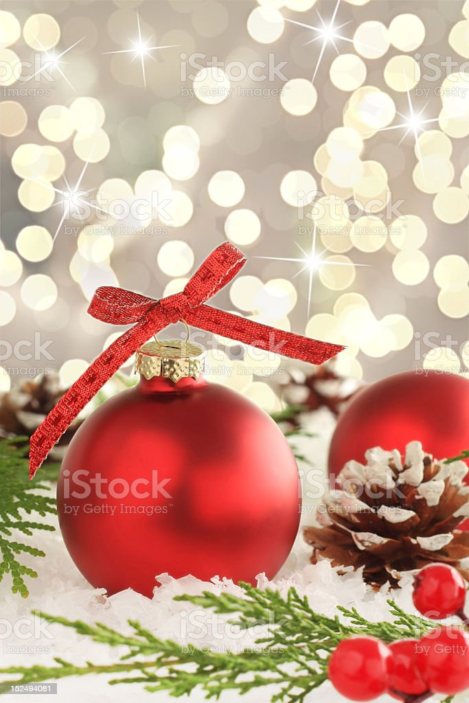 Red Christmas ornaments with pinecone on sparkly background royalty-free stock photo