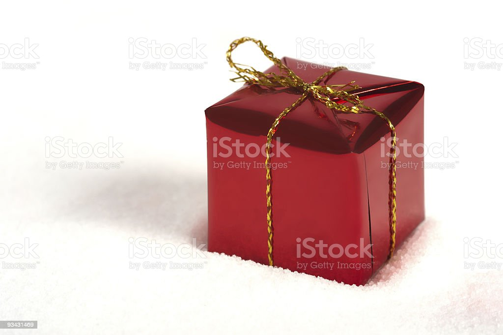 red Christmas present lying in the snow royalty-free stock photo