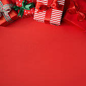 istock Red Christmas presents on red 1043770118