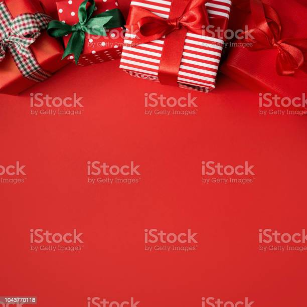 Red christmas presents on red picture id1043770118?b=1&k=6&m=1043770118&s=612x612&h=t iffko2itmbhtyuuaz lmrhf0luqqg6linced j0sm=