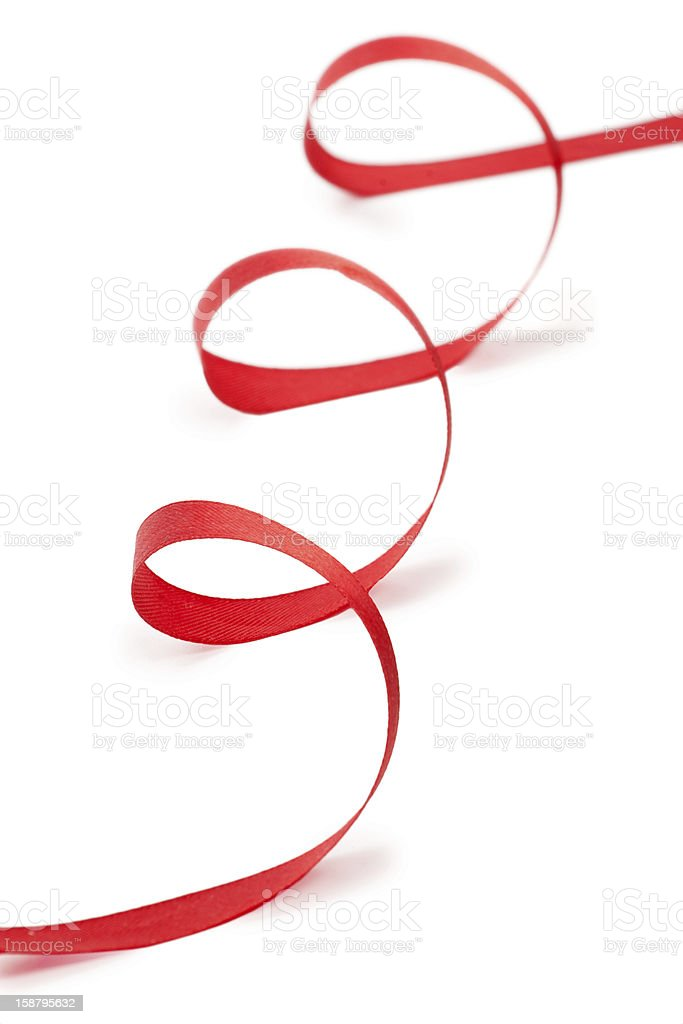 Red Christmas ribbon on white background royalty-free stock photo