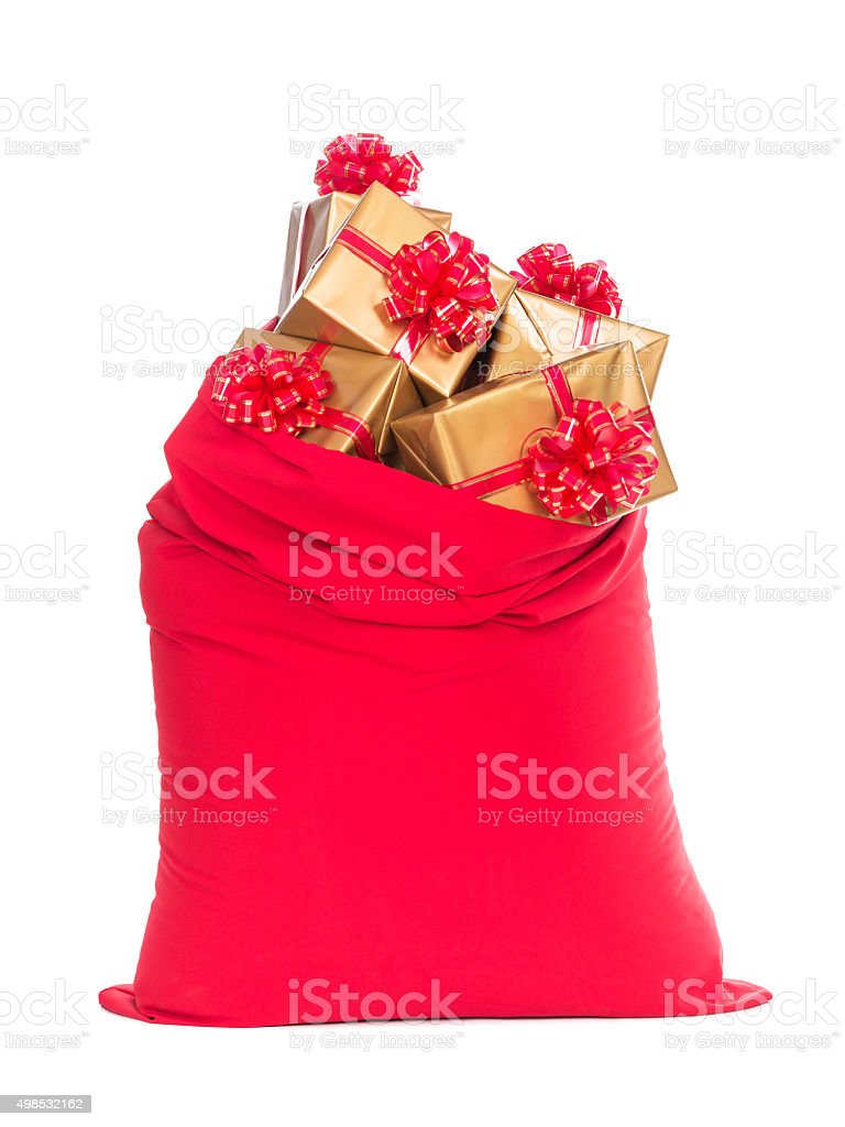 Red Christmas sack full of wrapped gift boxes isolated white stock photo