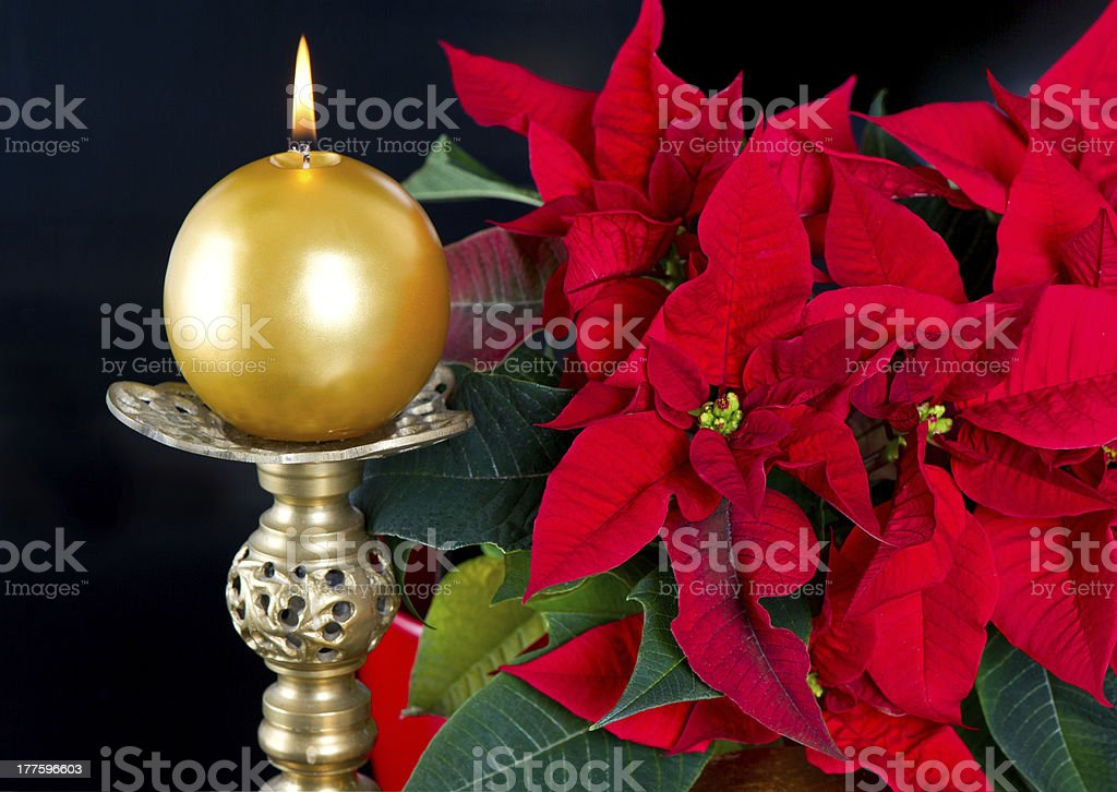 red christmas star with golden candle royalty-free stock photo