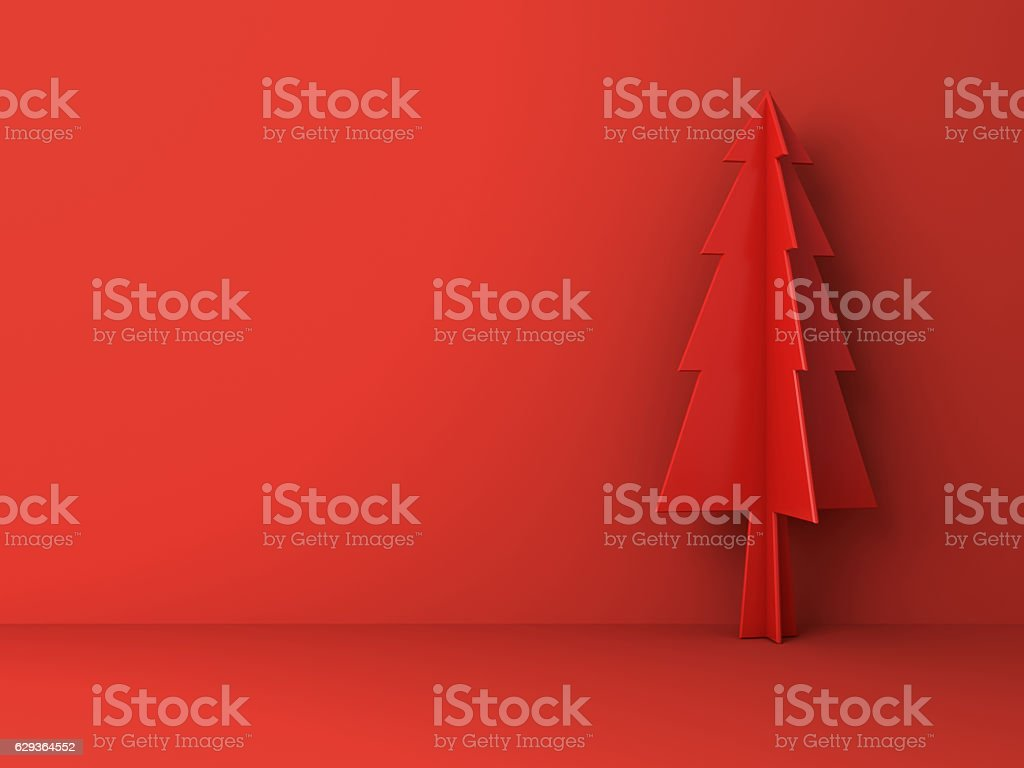 Red christmas tree on red background for christmas decoration stock photo