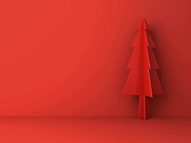 Red christmas tree on red background for christmas decoration - foto stock