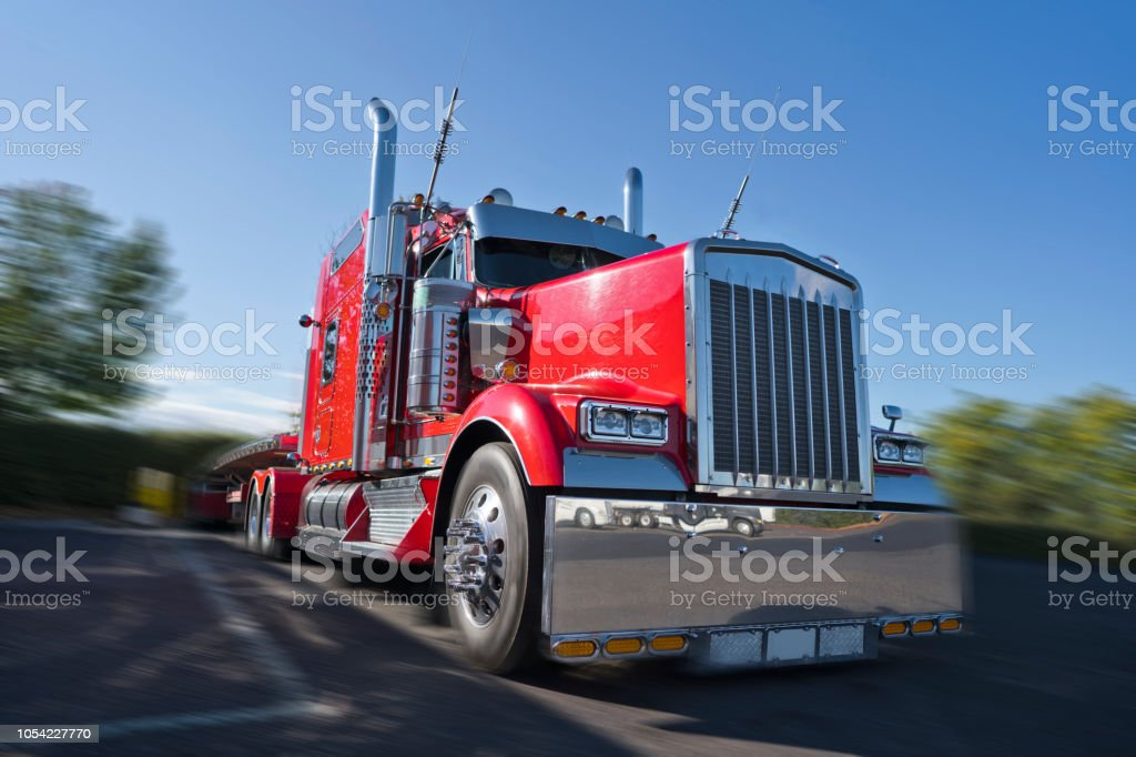 Red Classic Big Rig Semi Truck With Lot Of Chrome Accessories With Flat Bed Semi Trailer Stand On Truck Stop Stock Photo Download Image Now Istock