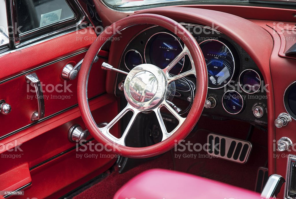 Red Classic Car Dashboard And Steering Wheel stock photo