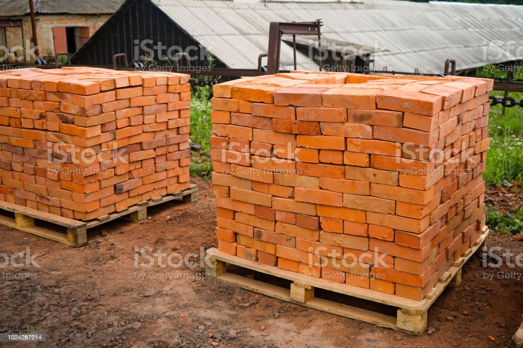 Red Clay Bricks Are Stacked On Wooden Pallets Production Of Bricks From Clay Stock Photo Download Image Now Istock