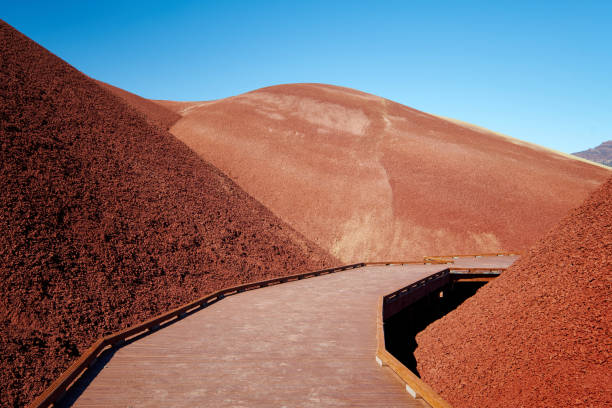 Red Clay Hills with Blue Sky and Wooden Foot Path stock photo