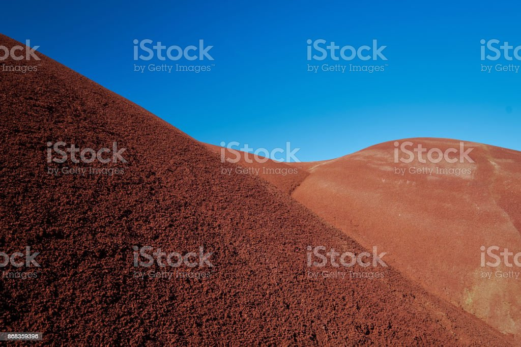 Red Clay Hills with Blue Sky stock photo